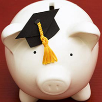 piggy bank with grad cap