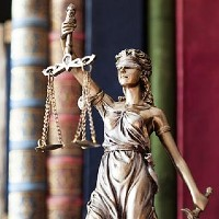 lady justice in front of books