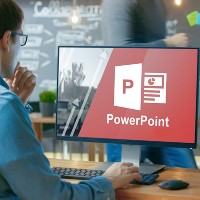 person opening powerpoint on a desktop